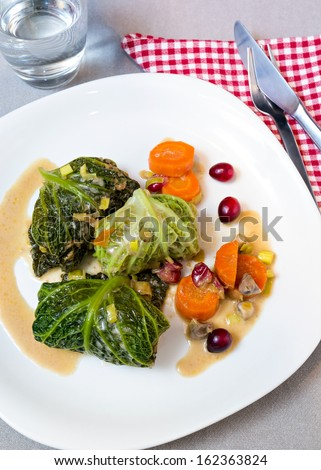 Traditional german food. Filled savoy cabbage with meat inside.
