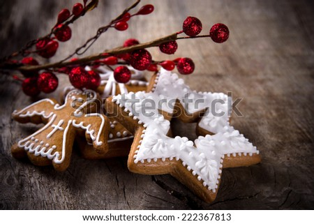 Traditional gingerbread cookies over wooden background