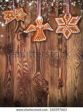 Traditional gingerbread hanging on wooden background