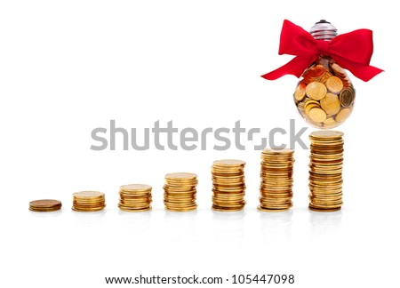 Traditional glass bulb with many golden coins - stock photo