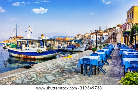 traditional Greece series - Chalki island with old boats and tavernas - stock photo