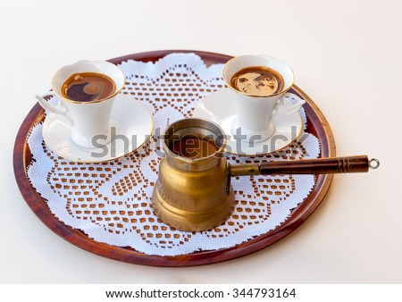 traditional Greek coffee served on a disk