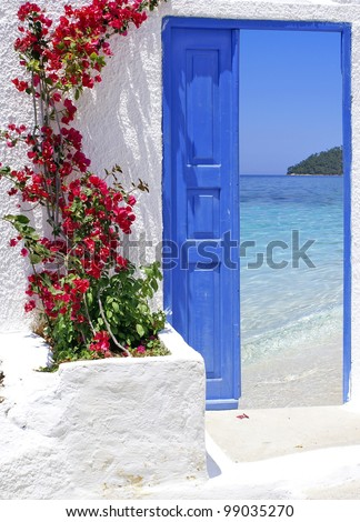 Traditional greek door with a great view on Santorini island, Greece - stock photo