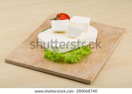 Traditional Greek Feta cheese with salad leaves