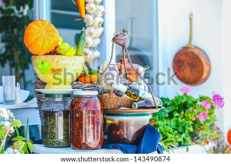 Traditional Greek food on the shop bench in Santorini - stock photo