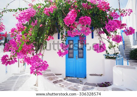 Traditional greek house with flowers in Paros island, Greece. - stock photo