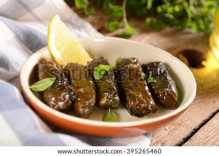 Traditional greek meal - Dolmadakia - stock photo