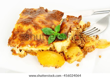 traditional greek moussaka with eggplant, potatoes, minced meat and bechamel sauce - stock photo