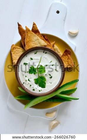 Traditional greek refreshing dip made of yogurt, cucumber and various herbs - stock photo
