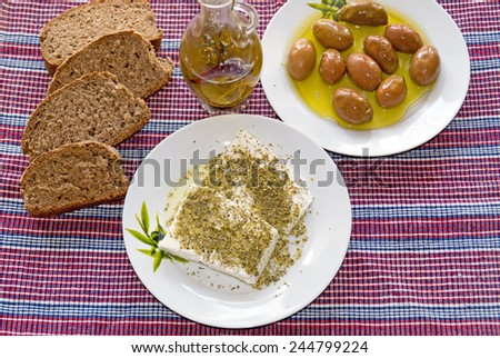 Traditional Greek salad with feta cheese, bread and Greek olives - stock photo