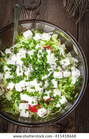 Traditional greek salad with  feta cheese, tomatoes and lettuce.