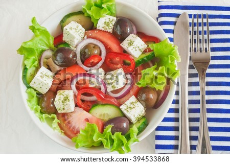 Traditional greek salad with fresh vegetables and feta cheese - stock photo