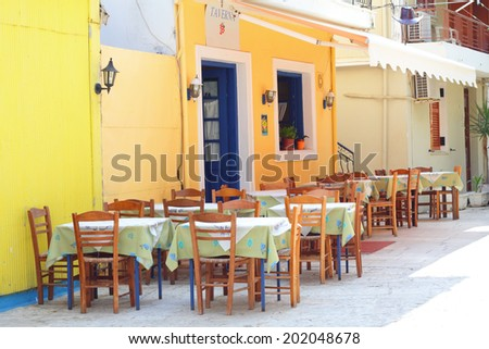 Traditional greek taverna in the streets of Lefkada Town in Greece - stock photo