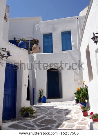 Traditional Greek village of whitewashed houses with blue windows and doors