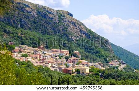 Traditional Greek village on the island of Corfu near Paleokastritsa. Corfu Island Kerkyra. - stock photo