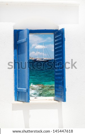 Traditional greek window on Sifnos island, Greece - stock photo
