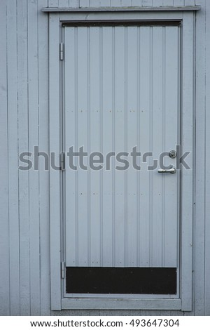 Traditional Grey Painted Wooden Door Set into a Wooden Doorframe and Wall