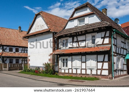 Traditional half-timbered houses in the streets of the small town of Hunspach in Alsace, France