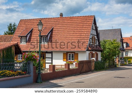 Traditional half-timbered houses in the streets of the small town of Seebach in Alsace, France - stock photo