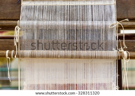 Traditional hand loom in a rug factory - stock photo