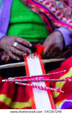 Traditional hand weaving in the Andes Mountains, Peru - stock photo