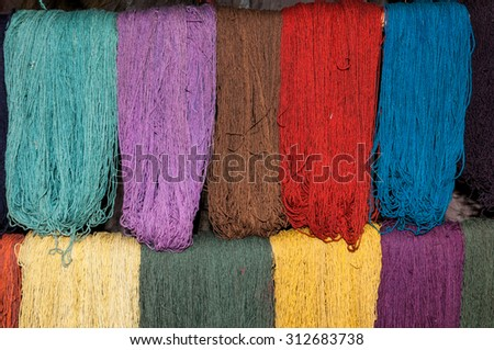 Traditional hand weaving in the Andes Mountains, Peru south america - stock photo
