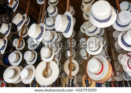 Traditional hats for sale in Cuenca, Ecuador - stock photo