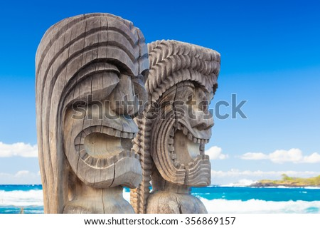 Traditional Hawaiian wood carving of guards at ancient Hawaiian site Pu'uhonua O Honaunau National Historical Park on Big Island, Hawaii