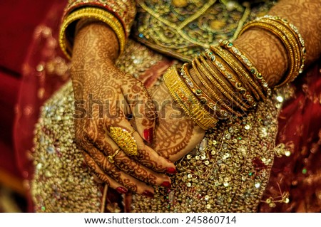 Traditional henna on brides hands on wedding in Bangladesh - stock photo