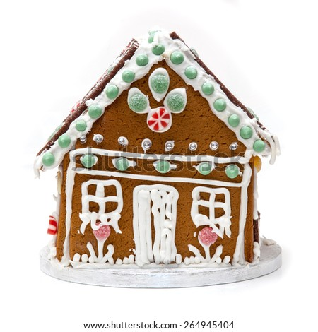 Traditional home made Ginger bread house isolated on a white studio background. - stock photo