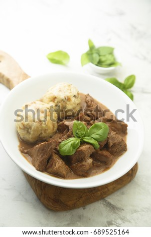 Traditional homemad beef goulash with dumplings