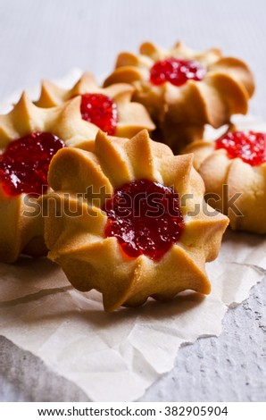 Traditional homemade cookies with red jam. Selective focus. - stock photo