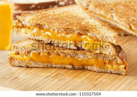 Traditional Homemade Grilled Cheese Sandwich on Whole Wheat Bread - stock photo