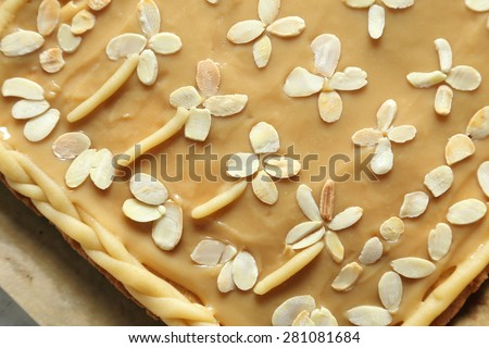 Traditional homemade, Polish baking. Shortbread cake with custard sprinkled with almonds. - stock photo