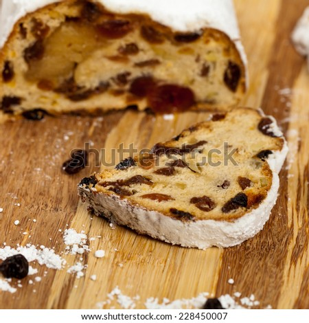 Traditional homemade stollen with dried fruits and nuts. Selective focus.