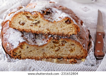 Traditional homemade stollen with raisins and nuts, close up - stock photo