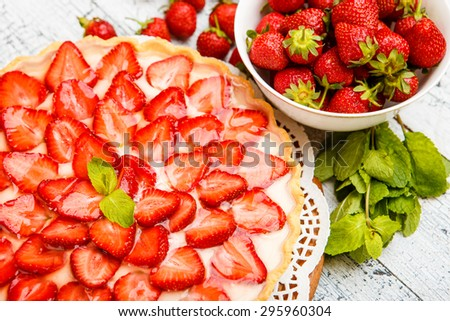 Traditional homemade strawberry cake on wooden background