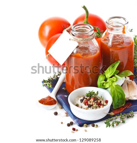 Traditional homemade tomato sauce with empty name tag and ingredients. - stock photo