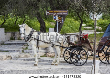 Traditional horse-drawn vehicle in Athens,Greece - stock photo