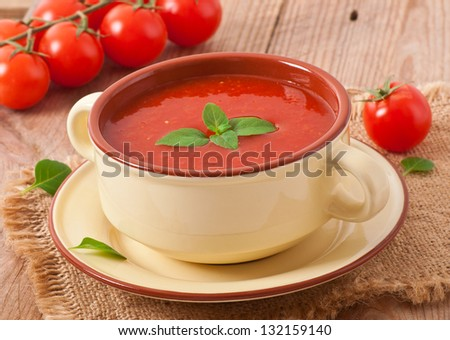 Traditional hot fresh diet tomato soup with basil