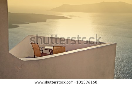 Traditional house at Santorini island in Greece with view to the volcanic caldera - stock photo