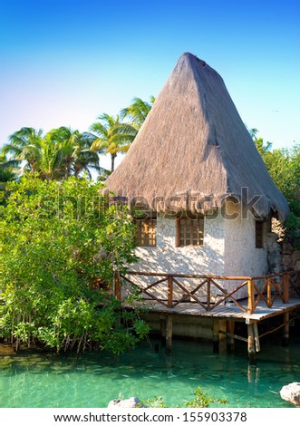 traditional house in park near Cozumel, Mexico.. - stock photo