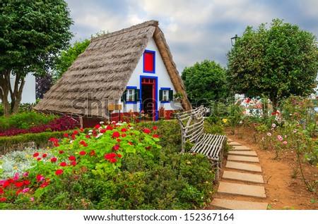 Traditional house in Santana village, Madeira island, Portugal - stock photo