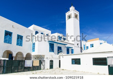 Traditional houses in Sidi Bou Said, Tunisia, city tower - stock photo