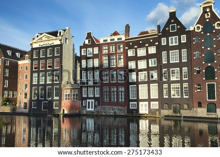 Traditional houses of Amsterdam with canal reflections. (The Netherlands).