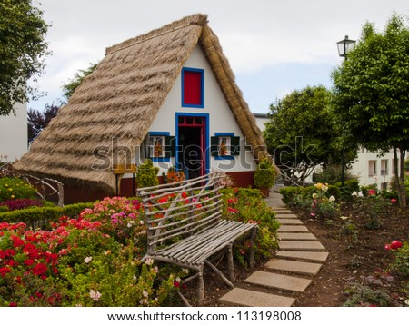 traditional houses with triangular rooftops protected by straw - Madeira - stock photo