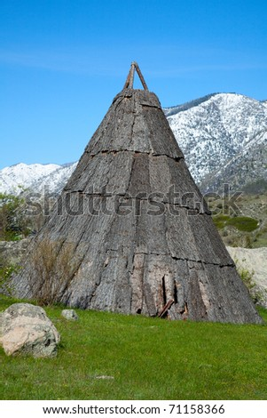 Traditional housing from the bark of the indigenous populations of Asia and America - stock photo