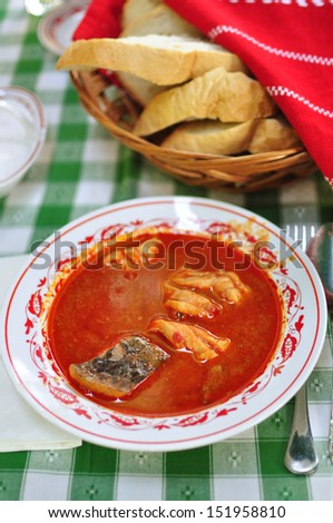 Traditional Hungarian fish soup  - stock photo