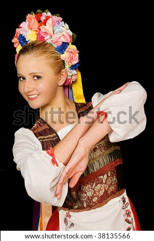 Traditional hungarian folk dancer wearing costume and headpiece - stock photo