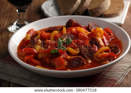 Traditional Hungarian Lecso with spiced sausage - stock photo